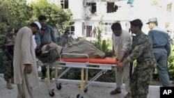 An Afghan security guard, who was wounded in a suicide bombing, is taken to the hospital for treatment, in Kandahar, Afghanistan, October 31, 2011.