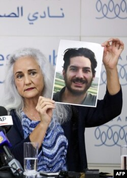Debra Tice, mother of U.S. journalist Austin Tice, who was kidnapped in Syria five years ago, holds a dated portrait of him during a press conference in Beirut, Lebanon, July 20, 2017.