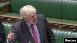 Britain's Prime Minister Boris Johnson gestures as he speaks during the weekly question time debate in Parliament in London, Sept. 30, 2020, in this screen grab taken from video.