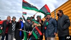 Libyans mark the 10th anniversary of their 2011 uprising that led to the overthrow and killing of longtime ruler Moammar Gadhafi, in Benghazi, Libya. The country has become one of the most intractable conflicts left over from the Arab Spring…