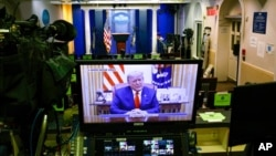 An image on a monitor shows U.S. President Donald Trump speaking during in a video posted on the White House Twitter feed, in the empty Brady Briefing Room of the White House in Washington, Jan. 13, 2021.