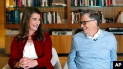 FILE - Bill and Melinda Gates smile at each other during an interview in Kirkland, Wash., Feb. 1, 2019.