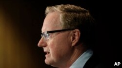 FILE - Reserve Bank Gov. Philip Lowe outlines measures the bank will take to support an economy rocked by international travel restrictions, bans on large public gatherings and escalating unemployment, in Sydney, March 19, 2020.