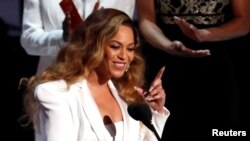 FILE - Beyonce reacts after winning the entertainer of the year award, 50th NAACP Image Awards, Los Angeles, California, March 30, 2019.