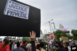 Demonstrators protest, June 5, 2020, in Atlanta. Protests continued following the death of George Floyd, who died after being restrained by Minneapolis police officers on May 25.