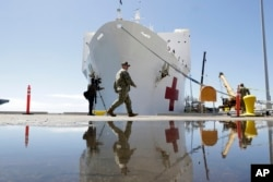 The USNS Mercy hospital ship is prepared for departure on March 23, 2020, in San Diego.