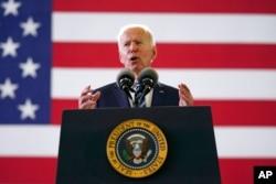 FILE - President Joe Biden speaks to American service members at RAF Mildenhall in Suffolk, England, June 9, 2021.