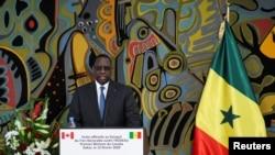 Le président sénégalais Macky Sall assiste à une conférence de presse conjointe avec le Premier ministre canadien Justin Trudeau au palais présidentiel de Dakar, au Sénégal, le 12 février 2020.