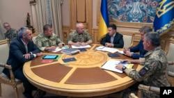 FILE - Ukrainian President Volodymyr Zelenskiy, third right, attends a meeting with Ukrainian top military officials in Kyiv, Ukraine, Aug. 7, 2019. (Ukrainian Presidential Press Office via AP)