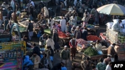 Traders and customers gather to bargain prices of commodities at a crowded vegetable market during a government-imposed nationwide lockdown as a preventive measure against the COVID-19 coronavirus, in Peshawar on April 2, 2020.