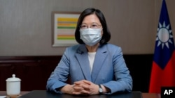 In this photo released by the Taiwan Presidential Office, Taiwan's President Tsai Ing-wen speaks at the presidential office in Taipei, Taiwan, June 20, 2021.