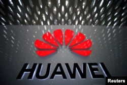 FILE PHOTO: A Huawei company logo at Shenzhen International Airport in Shenzhen, Guangdong province, China, July 22, 2019. REUTERS/Aly Song/File Photo