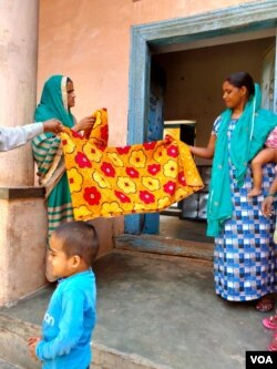 Women in Kasan, india benefitted from growing family incomes as migrant workers brought an economic boom. (VOA/A. Pasricha)
