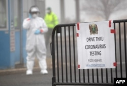 STAMFORD, CT - MARCH 20: A sign sits on a barrier at a coronavirus (COVID-19) drive thru testing location operated by Murphy Medical Associates at Cummings Park on March 20, 2020 in Stamford, Connecticut. We are still at the beginning of this public…