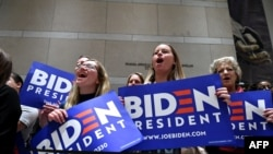 Supporters of Democratic presidential hopeful former Vice President Joe Biden cheers as he speaks at the National Constitution Center in Philadelphia, on March 10, 2020.
