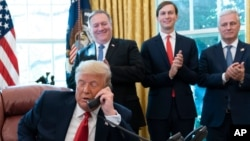 President Donald Trump talks on a phone call with the leaders of Sudan and Israel. (File)