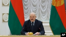 Belarus President Alexander Lukashenko addresses Prime Ministers from the Commonwealth of Independent States during a meeting, in Minsk, Belarus, May 28, 2021.