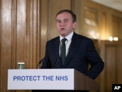 Britain's Secretary of State for the Environment George Eustice speaks during a Coronavirus press conference at Downing Street, in London, March 21, 2020.