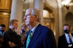 Senate Minority Leader Mitch McConnell, R-Ky., walks past the chamber as the Senate advances to formally begin debate on a roughly $1 trillion infrastructure plan at the Capitol in Washington, July 30, 2021.