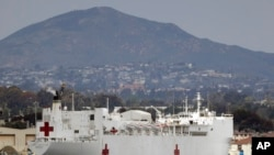 The USNS Mercy, a Navy hospital ship, is seen docked at Naval Base San Diego, March 18, 2020.