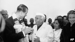 FILE - In this Jan. 21, 1959 file photo, India's Prime Minister Jawaharlal Nehru welcomes Britain's Prince Philip to New Delhi, India.