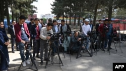 FILE - Journalists gather for a news event at Shahr-e-Naw Park in Kabul, Afghanistan, April 30, 2019.