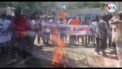 Manifestasyon Devan Kou Kasyon an pou Sipòte Manm Enstitisyon an