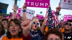 Supporters of Republican presidential candidate Donald Trump cheer during a campaign rally in Tampa, Florida, Oct. 24, 2016.