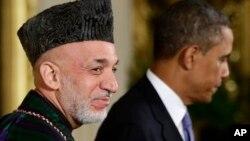 阿富汗总统卡尔扎伊与美国总统奥巴马在白宫联合举行记者会。(2013年1月11日)