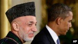 Afghan President Hamid Karzai smiles at the end of a joint news conference with President Barack Obama in January. (FILE)