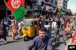 Aksi protes warga Afghanistan di Jalalabad, 18 Agustus 2021. (Pajhwok / AFP)