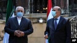 14일 이란의 모하마드 자바드 자리프 외무장관이 대형 폭발 사고가 난 레바논의 베이루트를 방문해 새로 임명된 샤르벨 와흐비 레바논 외무장관과 기자회견을 가졌다.