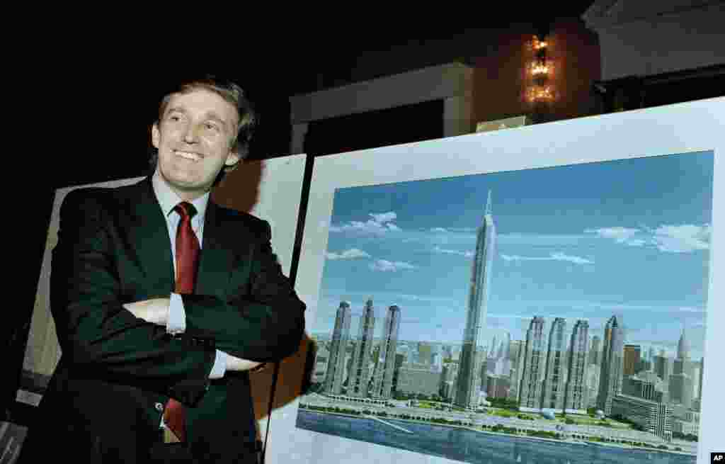"Real estate mogul Donald J. Trump displays an artist's concept of ""Television City,"" which would be on the far west side of Manhattan, Nov. 18, 1985. (AP Photo/Marty Lederhandler)"