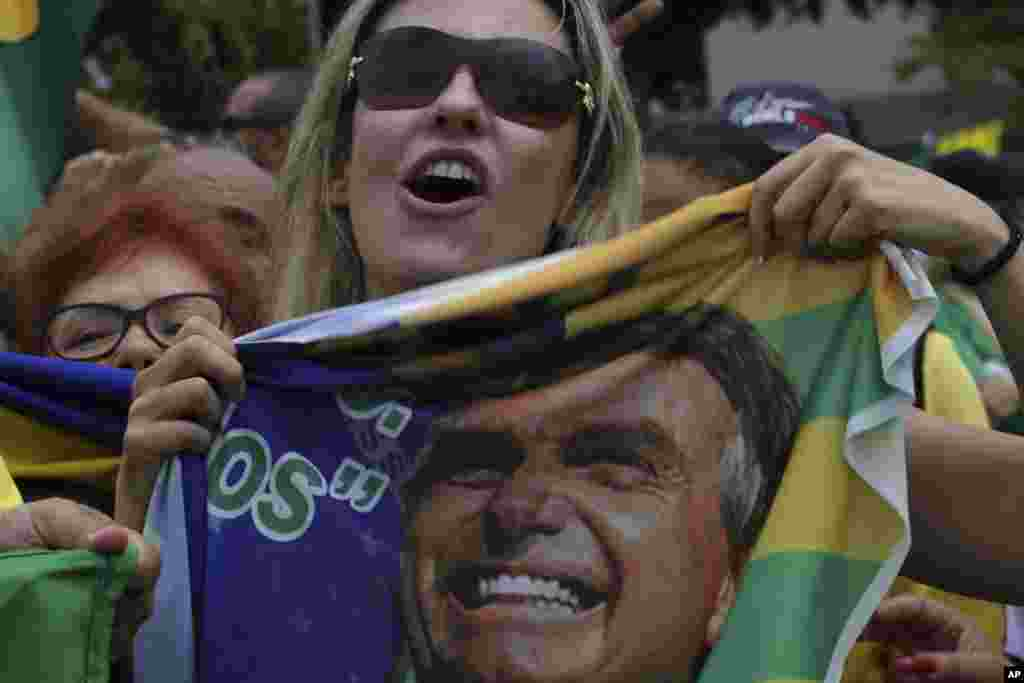 Supporters of presidential candidate Jair Bolsonaro of the right-wing Social Liberal Party, rally in Brasilia, Brazil, one week before Brazilians return to the polls for the second round of voting.