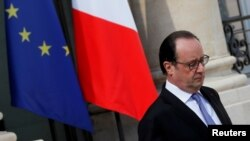 FILE - French President Francois Hollande leaves the Elysee Palace in Paris, July 15, 2016.