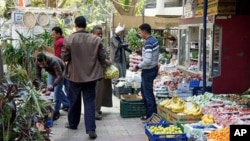 Markets are open and fully stocked as fresh produce comes in from the countryside and abroad. Cairo, February 7, 2011