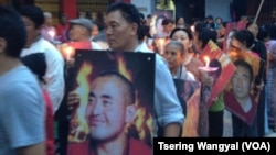 Tibetans in Delhi carrying posters of the Tibetans who self-immolated in China protest