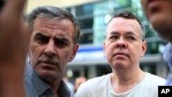 FILE - Andrew Craig Brunson (left), an evangelical pastor from Black Mountain, North Carolina, arrives at his house in Izmir, Turkey, July 25, 2018.
