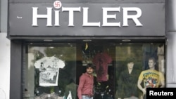 A customer walks out of a garment store named 'Hitler' in the western Indian city of Ahmedabad, September 4, 2012.