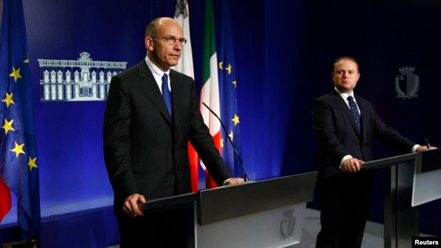 Italian Prime Minister Enrico Letta (L) and Malta's Prime Minister Joseph Muscat take part in a news conference at Muscat's office at the Auberge de Castille in Valletta, Malta, Nov. 11, 2013.