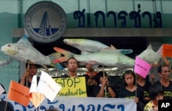 FILE - Thai villagers hold banners opposing the building of a dam on the Mekong river during a rally outside a construction company in Bangkok, Thailand, April 24, 2012. A new irrigation proposal — the Kong-Loei-Chi-Mun project — is sparking concerns from locals, environmentalists, and some development experts.