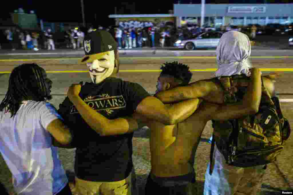 Protesters lock arms during another night of demonstrating in Ferguson, Aug. 11, 2015.