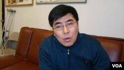 纽约市立大学史丹顿岛学院政治学教授夏明