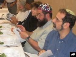 Jews and Muslims, seated side-by-side, share their thoughts during a Passover Seder at the All Dulles Area Muslim Society (ADAMS).