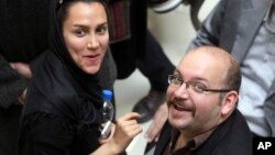 FILE - Jason Rezaian, a Washington Post, reporter, is pictured with his wife, Yeganeh Salehi, an Iranian correspondent for the Abu Dhabi-based newspaper The National.