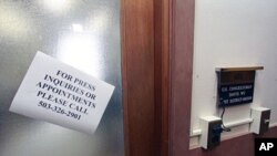A sign is posted on the door of Oregon Democratic Rep. David Wu's Portland office, July 26, 2011, in Portland, Oregon