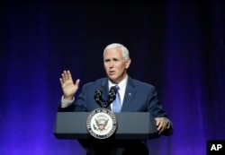 "Vice President Mike Pence waves goodbye as he wraps up an address to a NGA session titled ""Collaborating to Create Tomorrow's Global Economy,"" July 14, 2017, in Providence, Rhode Island."