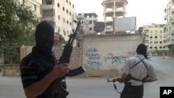 Thành viên thuộc lực lượng Giải phóng Syria tại một khu vực ở thủ đô Damascus
