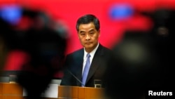 Hong Kong Chief Executive Leung Chun-ying looks on during a news conference in Hong Kong, July 15, 2014.