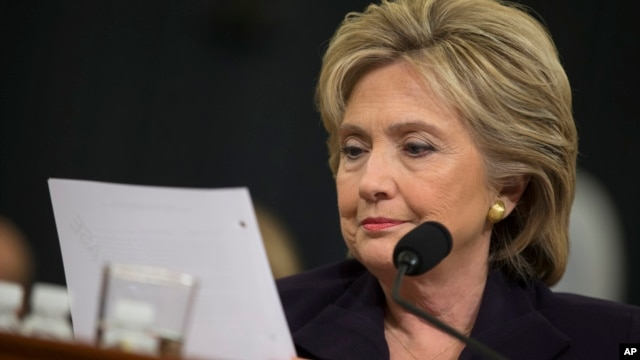 FILE - Democratic presidential candidate, former Secretary of State Hillary Rodham Clinton looks at an email sent by Ambassador Chris Stevens during her testimony before the House Benghazi Committee, Oct. 22, 2015, on Capitol Hill in Washington.